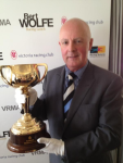 Caller Greg Miles with the 2012 Emirates Melbourne Cup